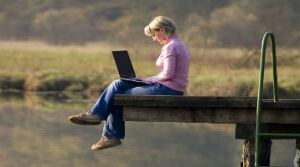 woman on computer visiting community online